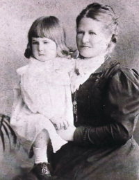 Fowler, Clara (1848-1925) holding child